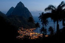 The village of Soufriere lit up as night falls. the Pitons in the background are volcanic plugs rising straight out ogf the sea. Photo by Tri-X Pan.