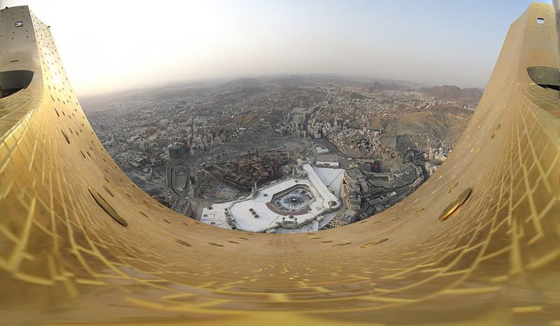 panoramic overview of the city of Makkah (Saudi Arabia) taken from the crescent located at the top of Abraj-Al-Bait-Towers in about 585m height. It was built from 67 single photos. It covers about 180° from west over north to east. Photo by Wurzelgnohm.
