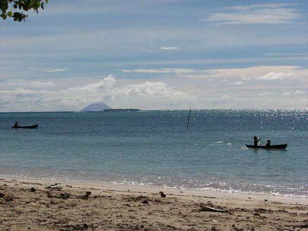 Looking towards the Great Reef from Fenualoa, Reef Islands, Solomon Islands. Active volcano Tinakula across the waters. Photo by Pohopetch.