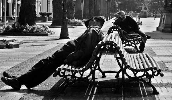 A couple of guys sleeping near the Kiosko Alfonso in A Coruña (Galicia, Spain). Photo by Julio Rojas.