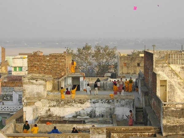 Photo of children flying kites from the rooftops in India. Photo by Yusuke Kawasaki.