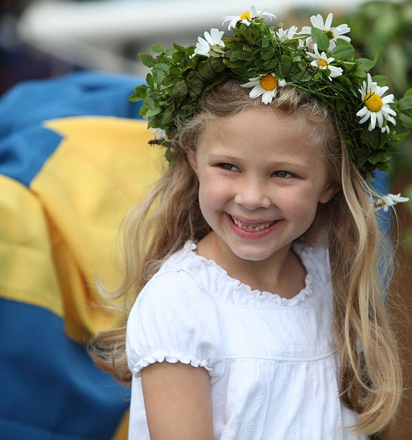 Swedish girl wearing a Midsummer crown. Photo by Bengt Nyman.
