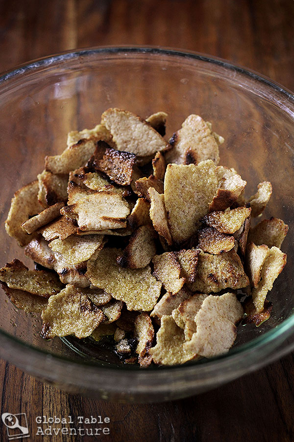 Toasting pita chips for Fattoush
