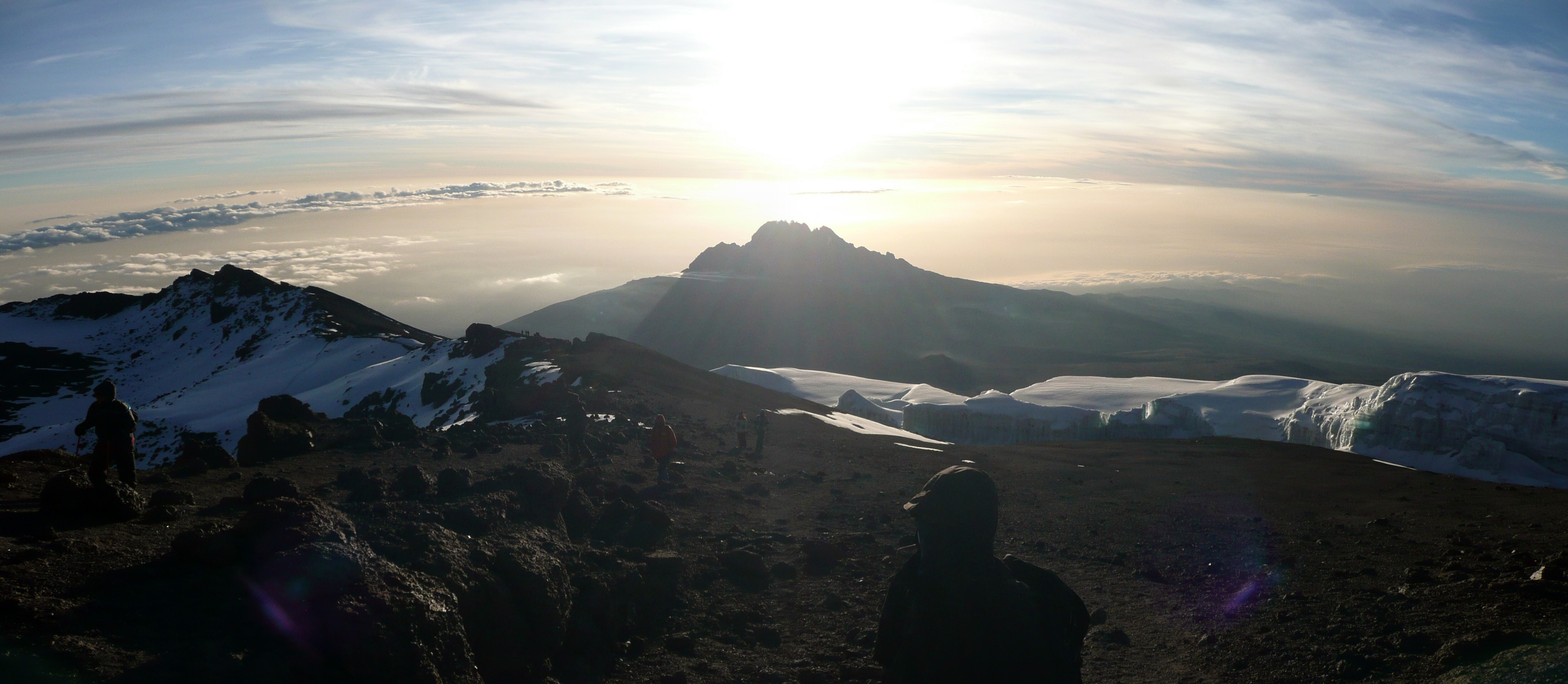 """Mawenzi Cone at sunrise from Kilimanjaro crater rim"" by Sbork - Own work. Licensed under CC BY-SA 3.0 via Wikimedia Commons - https://commons.wikimedia.org/wiki/File:Mawenzi_Cone_at_sunrise_from_Kilimanjaro_crater_rim.jpg#/media/File:Mawenzi_Cone_at_sunrise_from_Kilimanjaro_crater_rim.jpg"