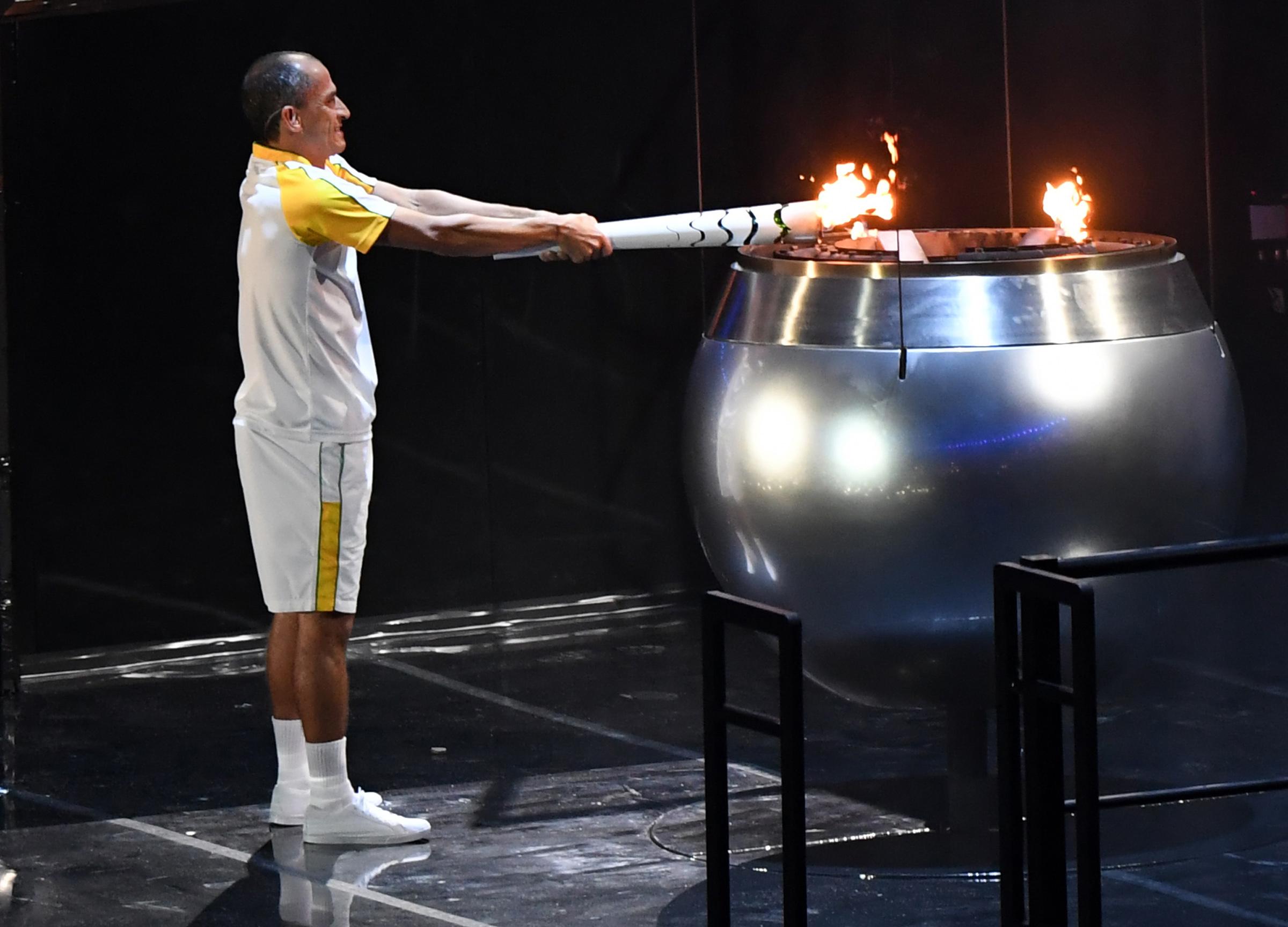 Vanderlei Cordeiro de Lima lights the Olympic cauldron during the Opening Ceremony of the 2016 Rio Olympic Games at Maracana Stadium in Rio de Janeiro, Brazil. U.S. Army photo by Tim Hipps, IMCOM Public Affairs.